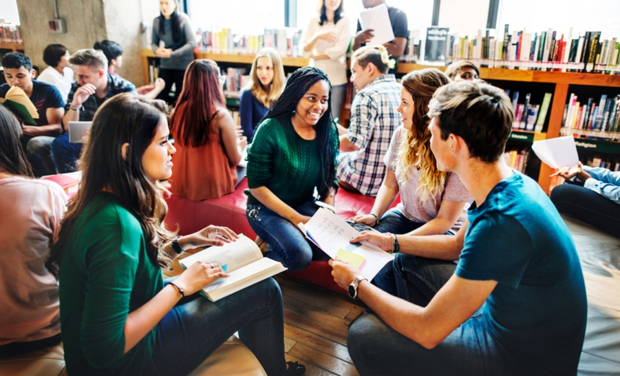 students talking in library