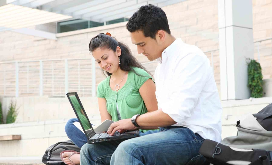two latino students studying