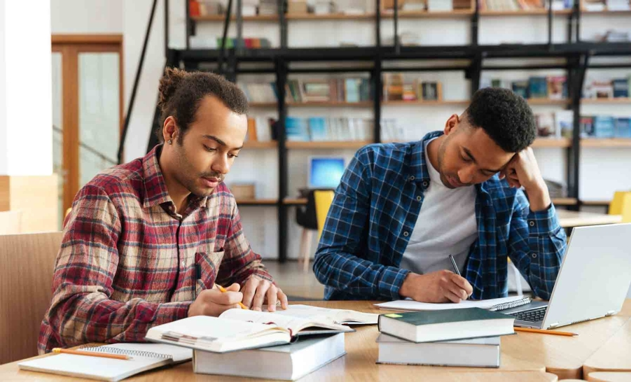 two black male students studying